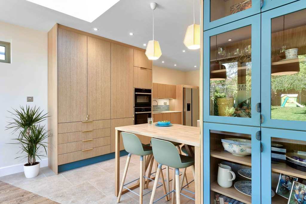 Sustainable kitchen Miinus Kitchens oak and blue glass units