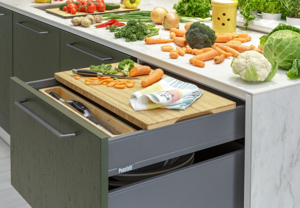 Sustainable kitchen Miinus Kitchens close-up of open drawer, chopping board and vegetables