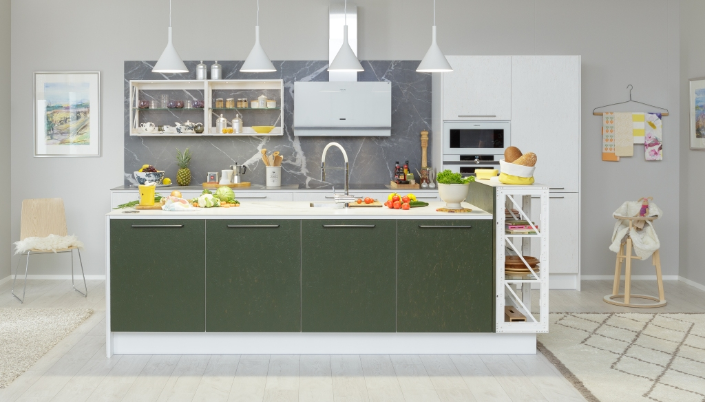 White and green sustainable kitchen Miinus Kitchens with island and ceramic backsplash